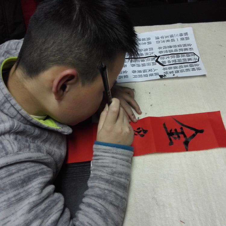 对王孟柯、王光远同学书写对联进行指教